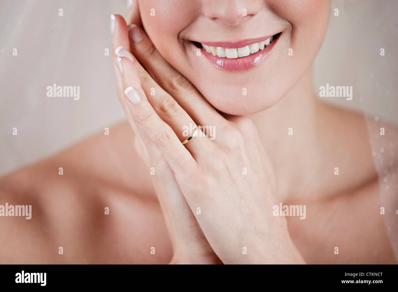 A young bride showing her wedding ring, close up - Stock Image