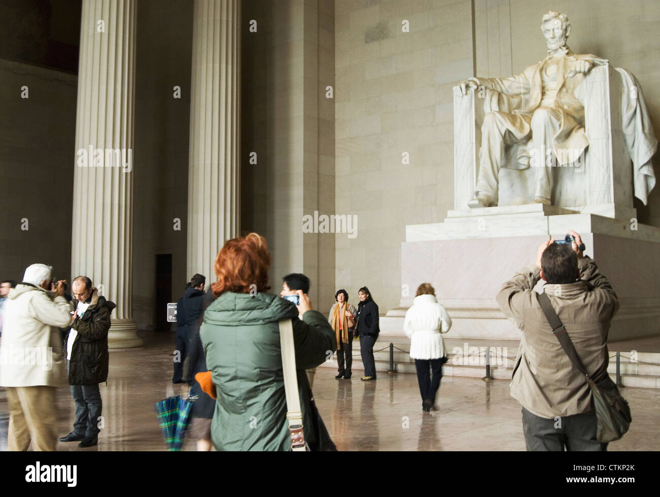 A group of tourists surrounding the Lincoln Memorial statue in Washington DC. Stock Photo