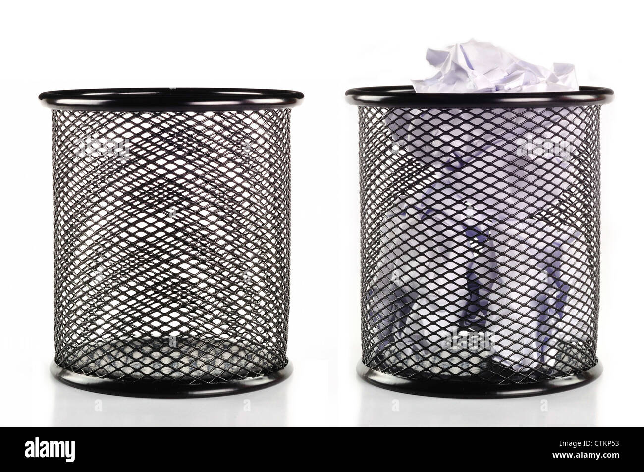 Trash can full of paper And empty the trash. - Stock Image