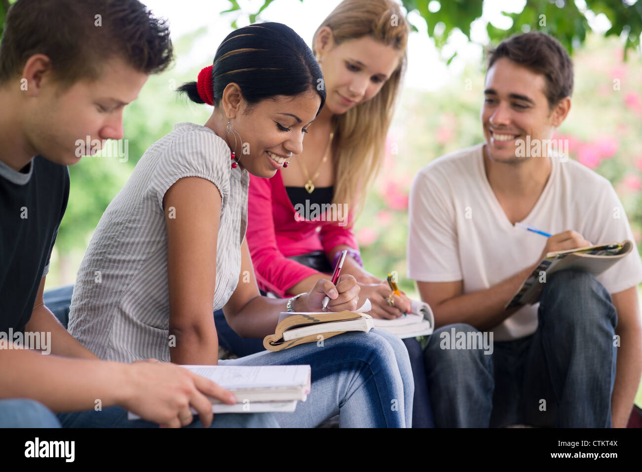 Friends and education, group of university students studying, reviewing homework and preparing test - Stock Image