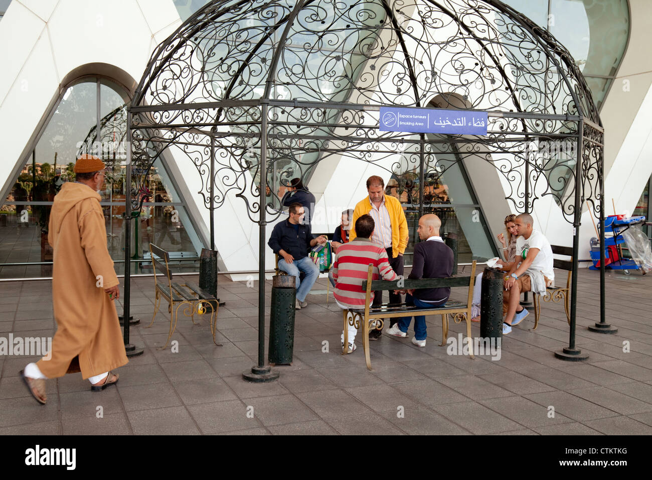 People in the smoking permitted area of the terminal, Marrakech airport, morocco Africa Stock Photo