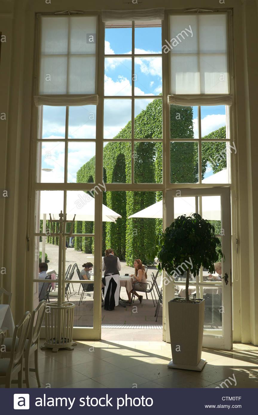 Schwetzingen Palace (Schloss Schwetzingen) cafe scene, looking out in to the gardens, Baden-Württemberg, Germany. - Stock Image