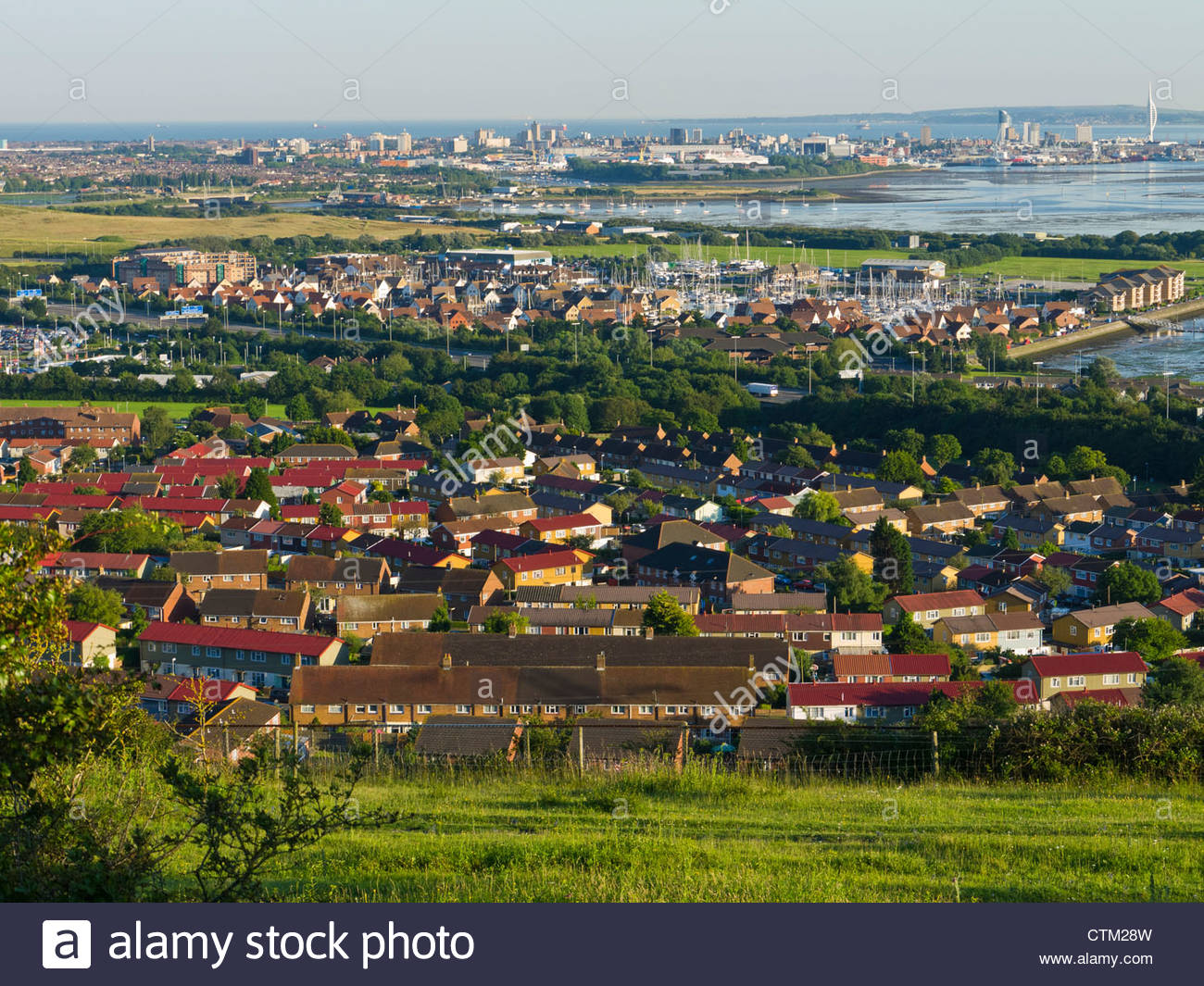 Portsmouth Urban Housing contrasts with Yacht Marina and City in Background - Stock Image