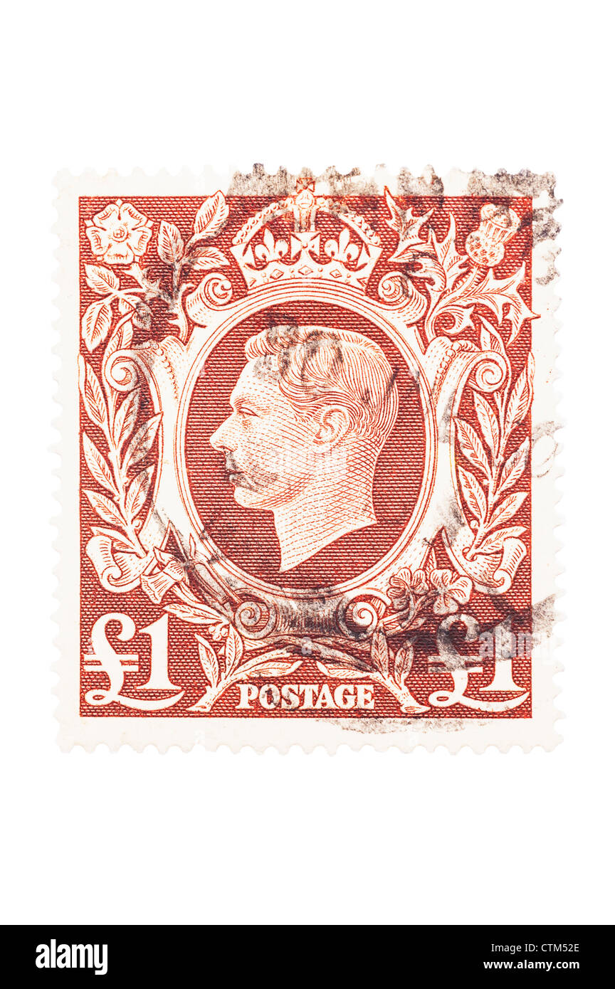 A King George VI one pound brown £1 postage stamp on a white background - Stock Image