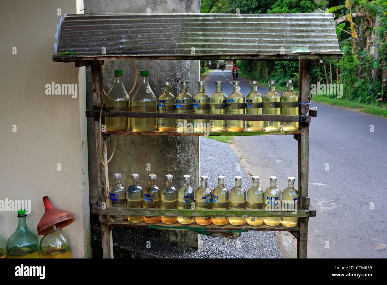 Bottles of petrol available for sale on a roadside stand. Near Ubud, Bali, Indonesia. - Stock Image