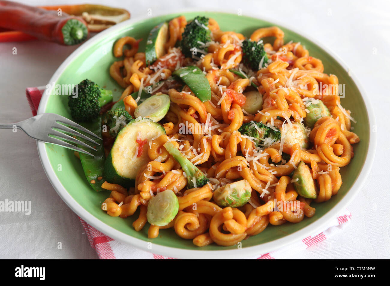 A plate of Macaroni pasta with tomato sauce - Stock Image
