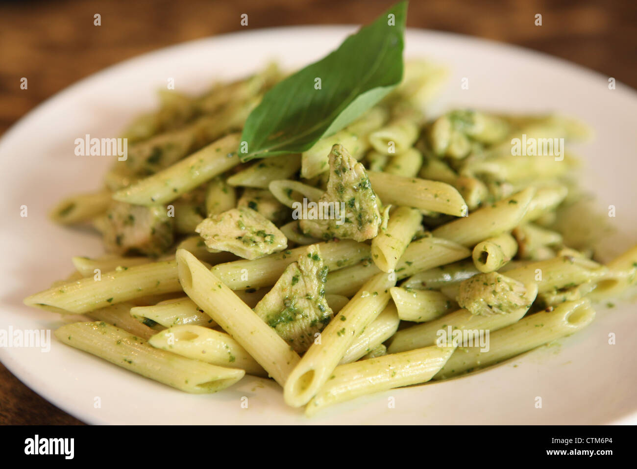 A serving of Penne pasta with herbs and cheese - Stock Image