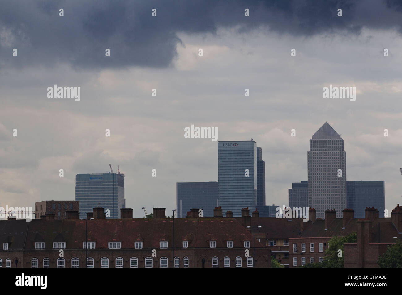 Grey skyline over Canary Wharf from Bow, East London towards financial district of London, England, United Kingdom - Stock Image