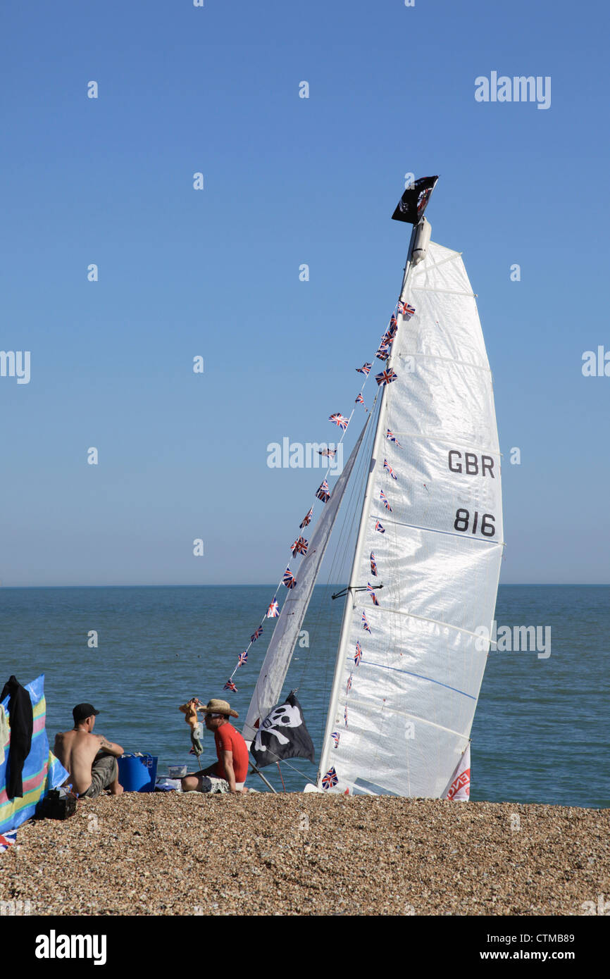 Members of Hythe and District Sailing Club on the beach - Stock Image