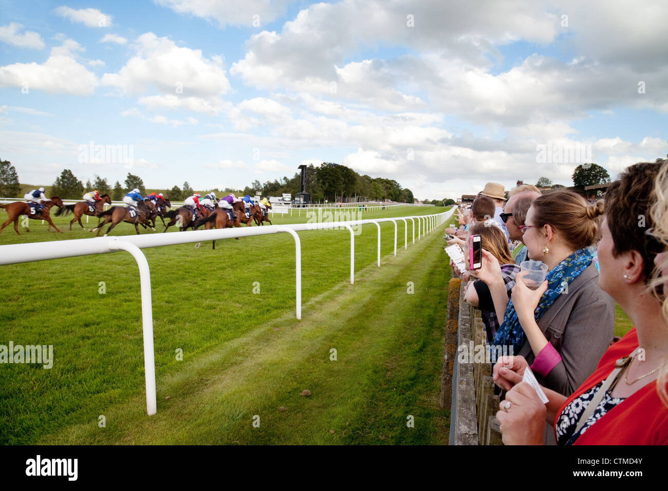 People watching the horse racing, Newmarket July racecourse, Newmarket Suffolk UK - Stock Image