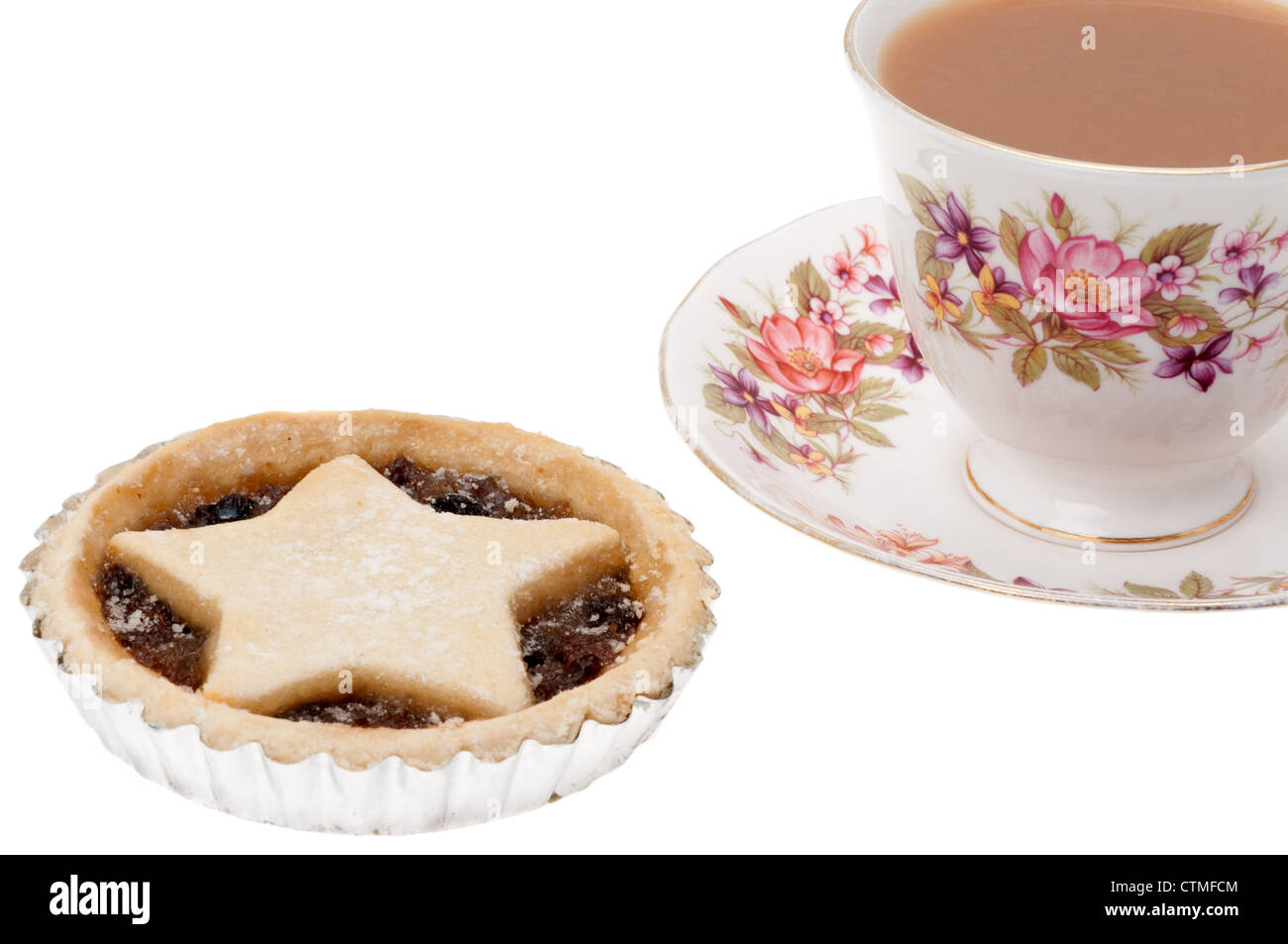 A single festive or Christmas mince pie with a cup of tea served in an ornate bone china cup and saucer - studio - Stock Image