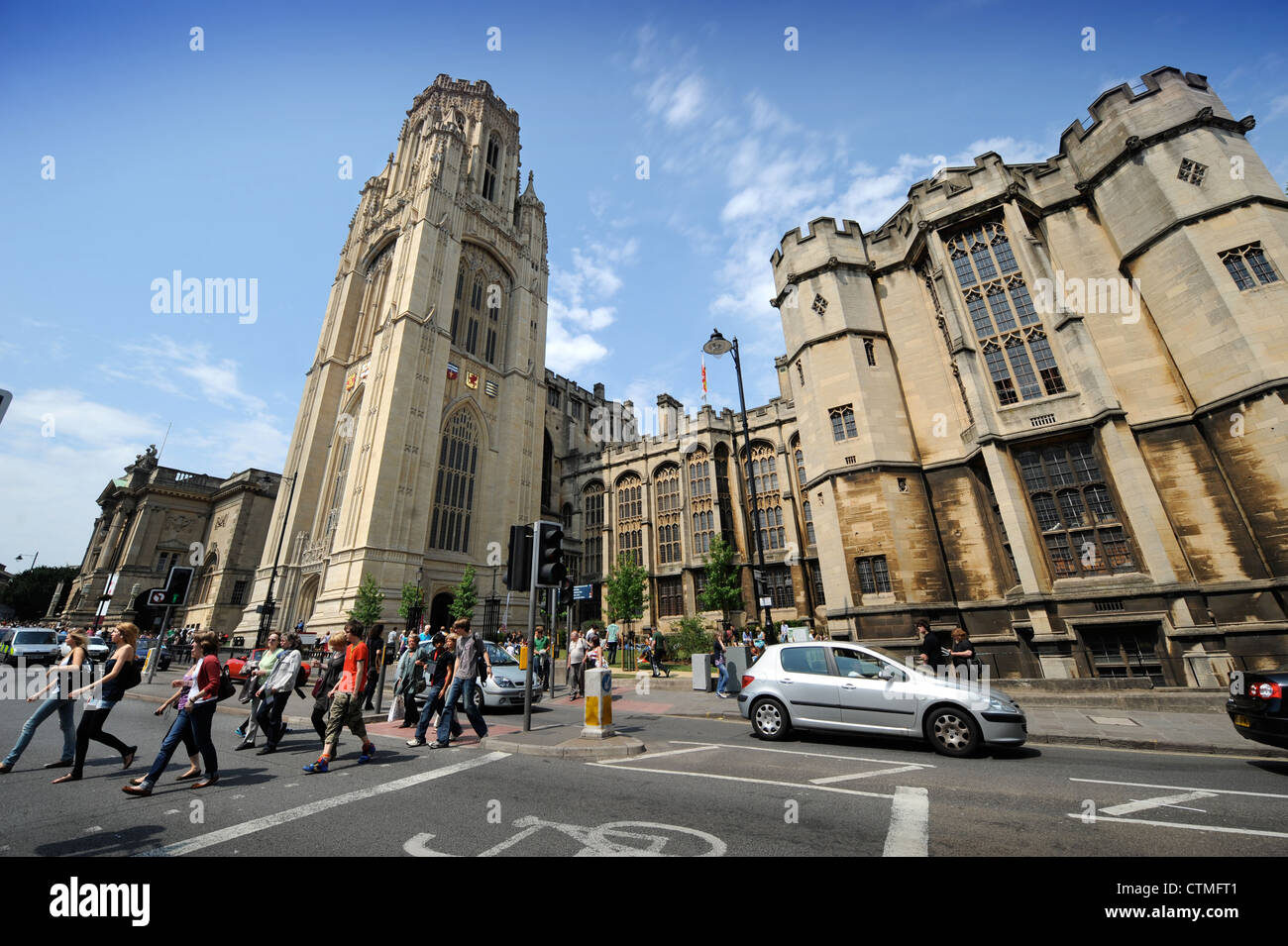 Students on a pedestrian crossing outside Bristol University's Wills Memorial Building UK - Stock Image