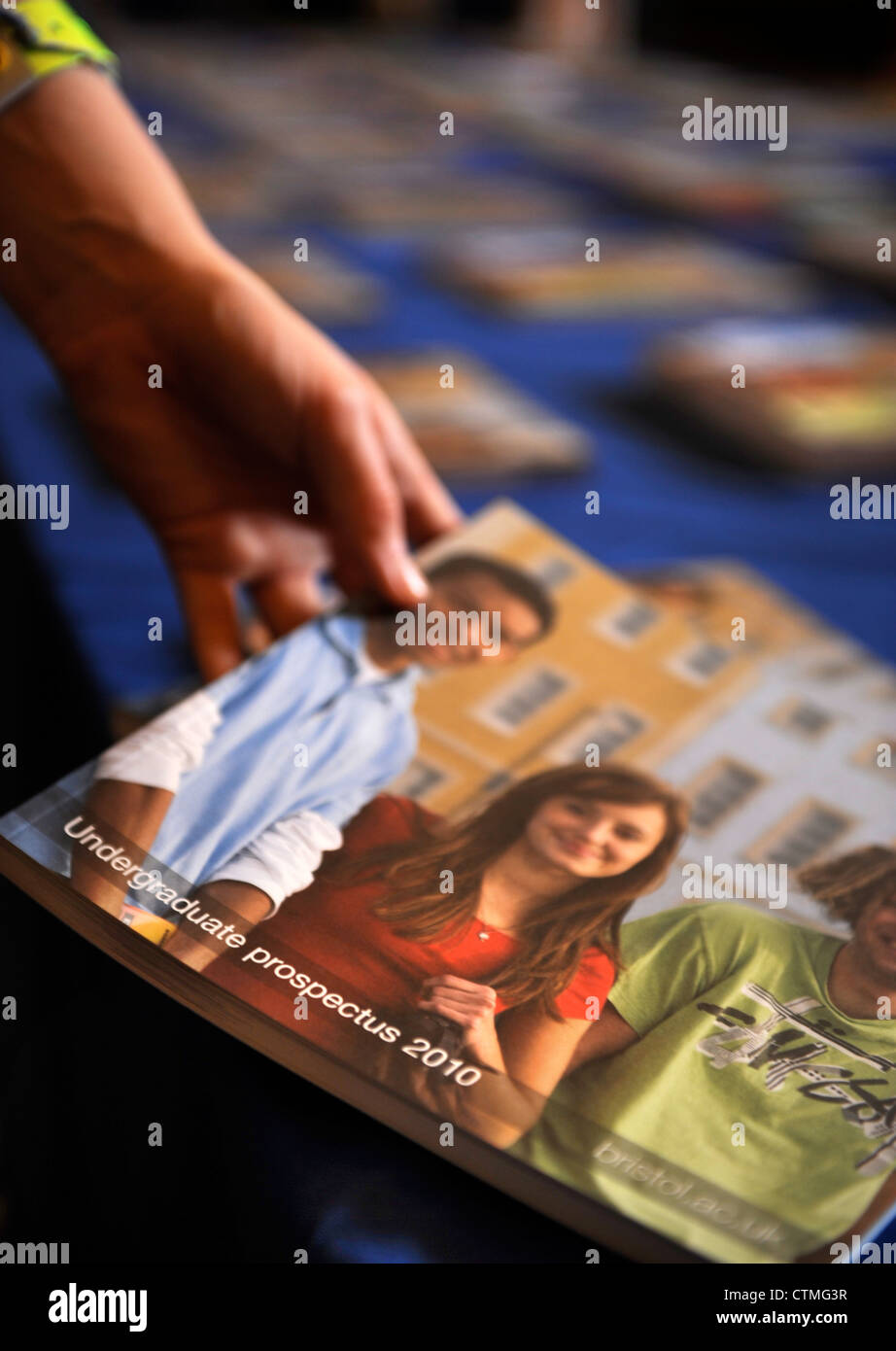 A student picks up a prospectus at an open day at Bristol University UK - Stock Image