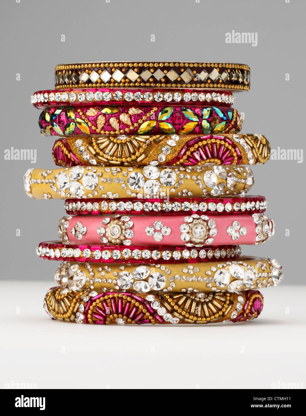 Costume jewelry. A stack of colorful bracelets. - Stock Image