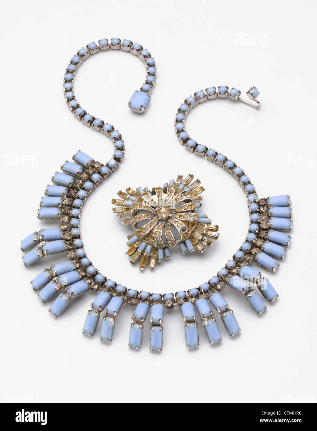 Costume jewelry. A a blue stoned necklace with matching broche - Stock Image