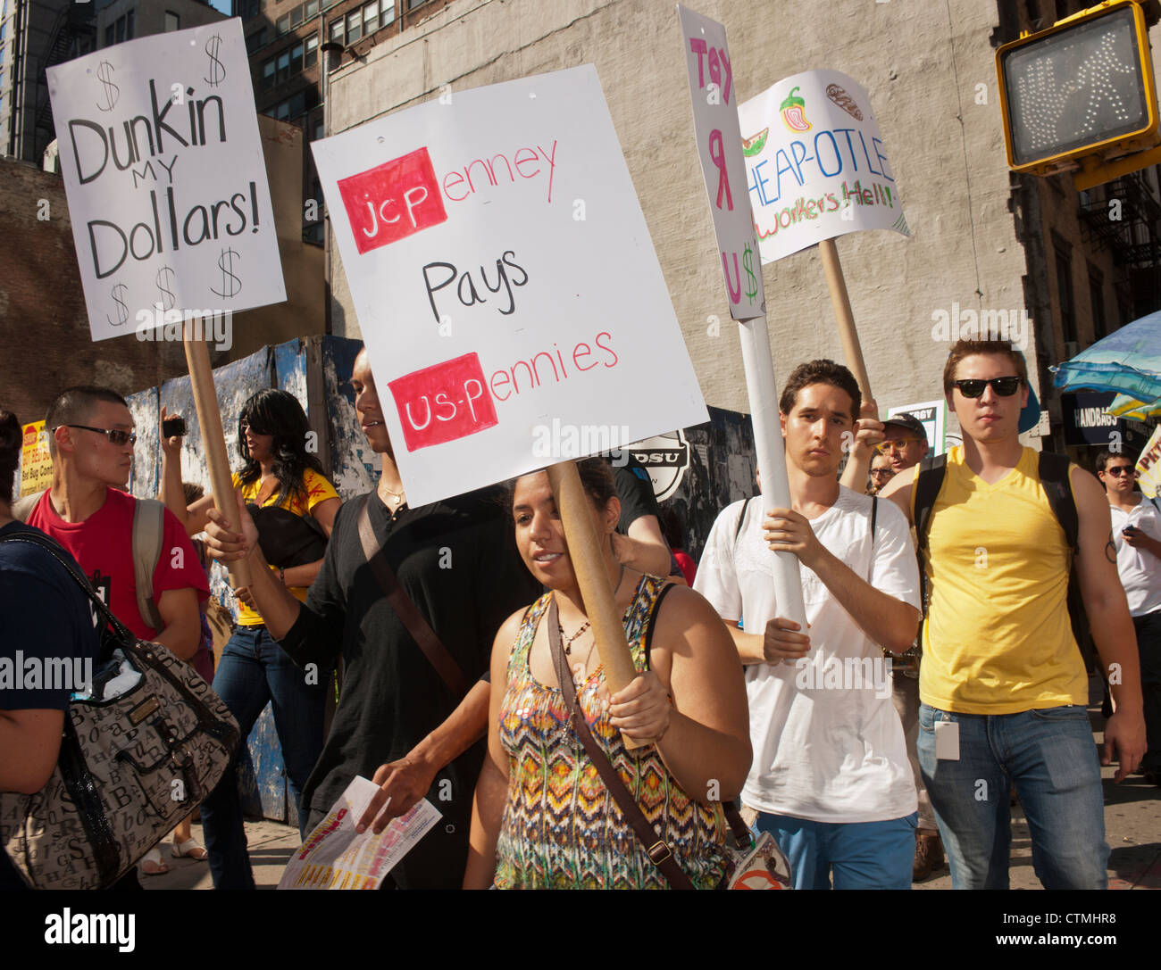 Hundreds of workers and supporters march in a demonstration for a living wage - Stock Image