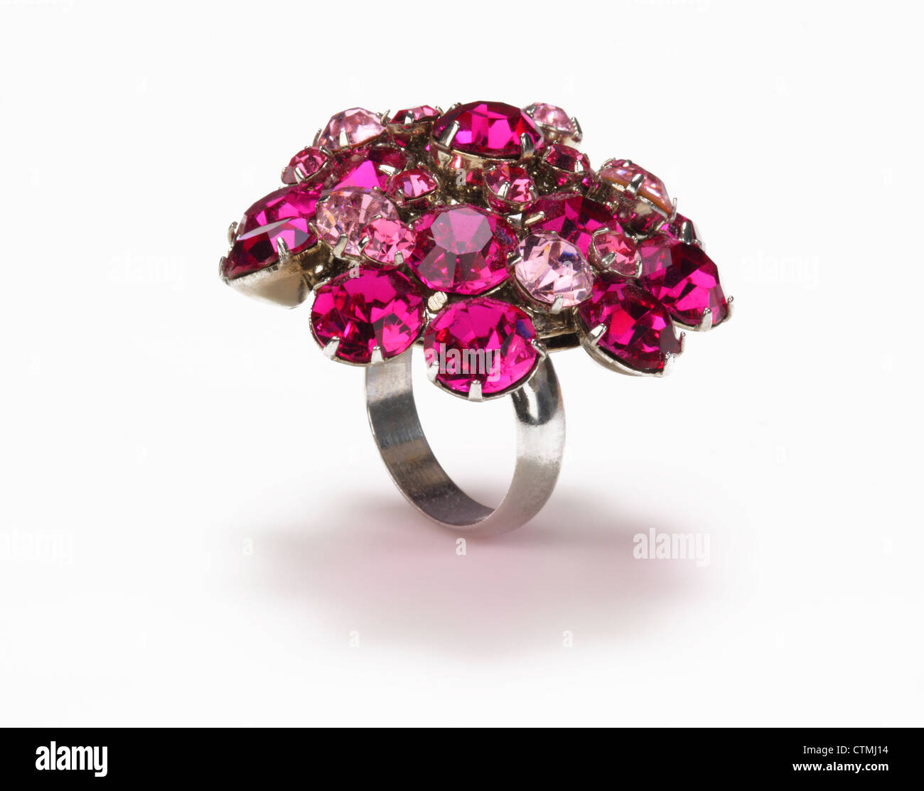 Costume jewelry. A ring with a cluster of red and pink jewels. - Stock Image
