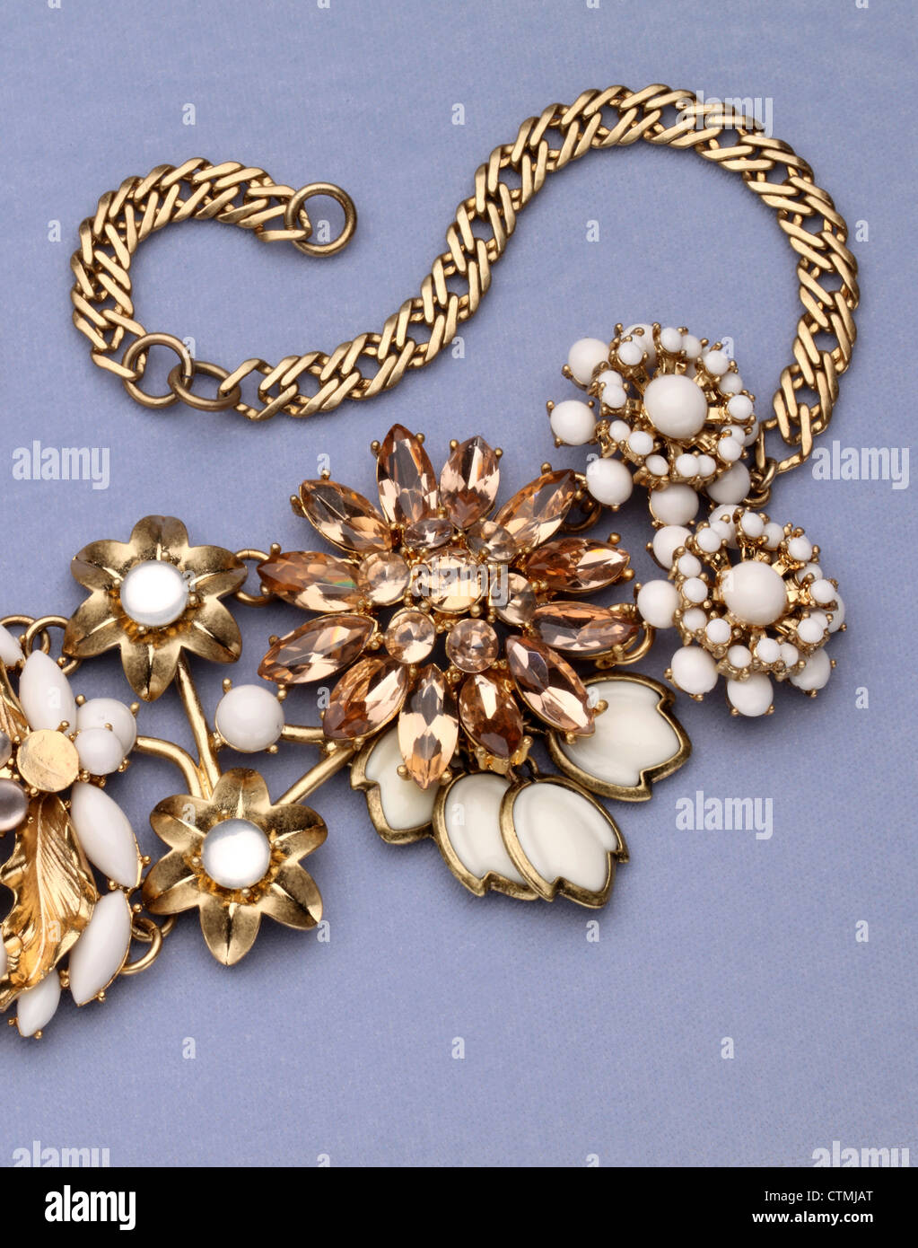 Costume jewelry. A large gold necklace with flowers. - Stock Image