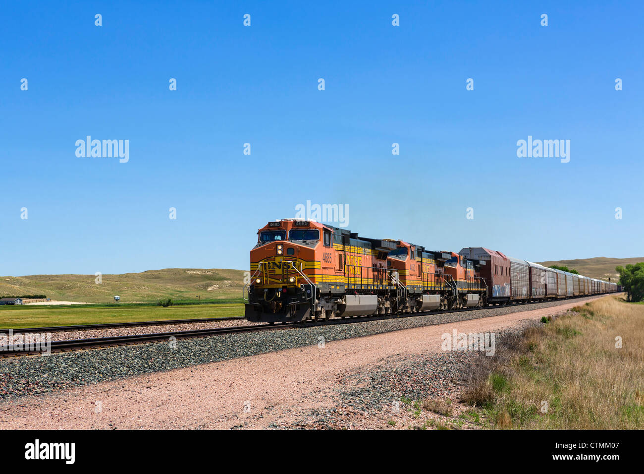 A 2km long freight train in rural Nebraska alongside the western portion of NE 2, Nebraska, USA - Stock Image