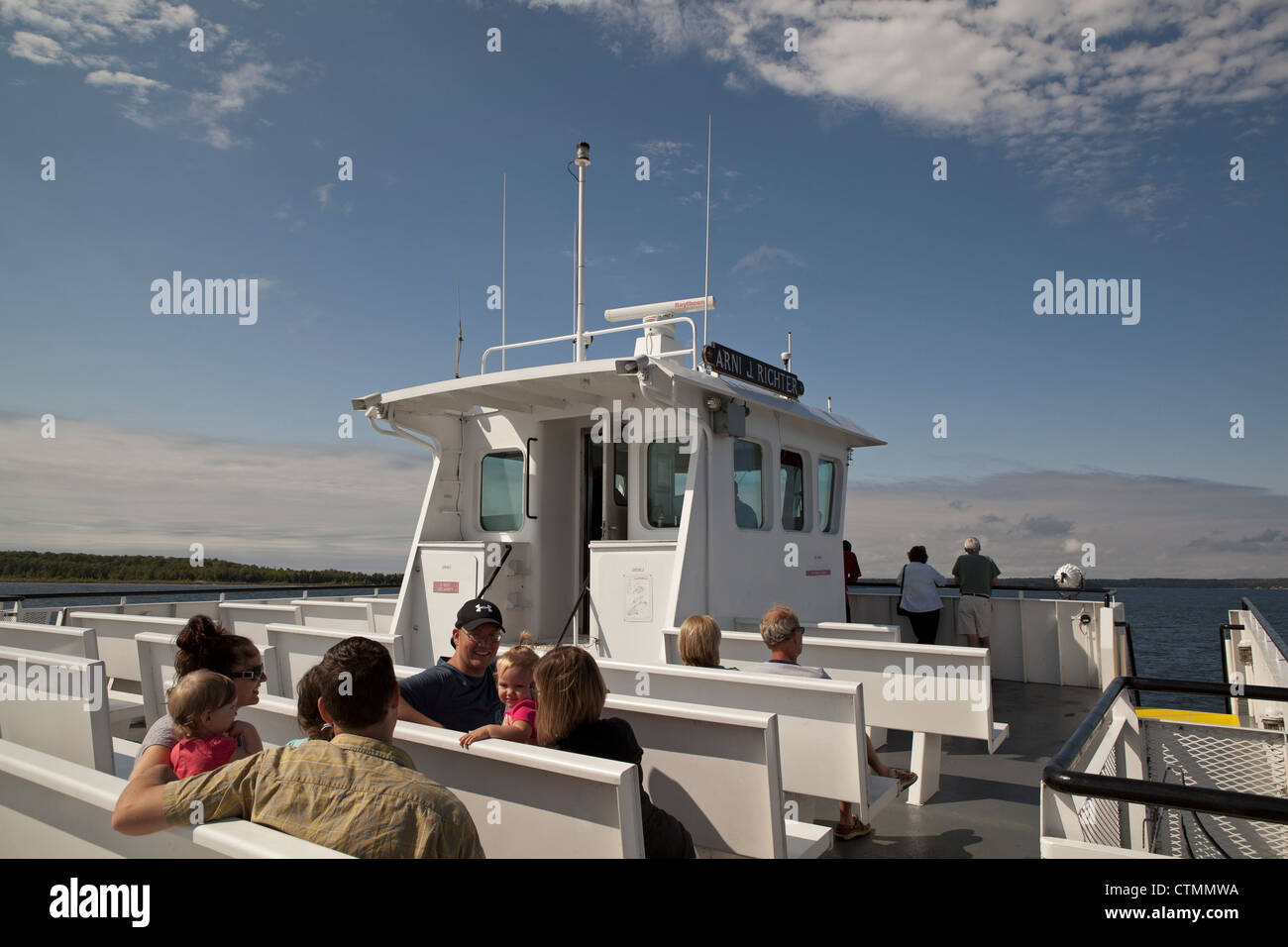 Families enjoy the ferry ride on Lake Michigan in Door County, Wisconsin. - Stock Image