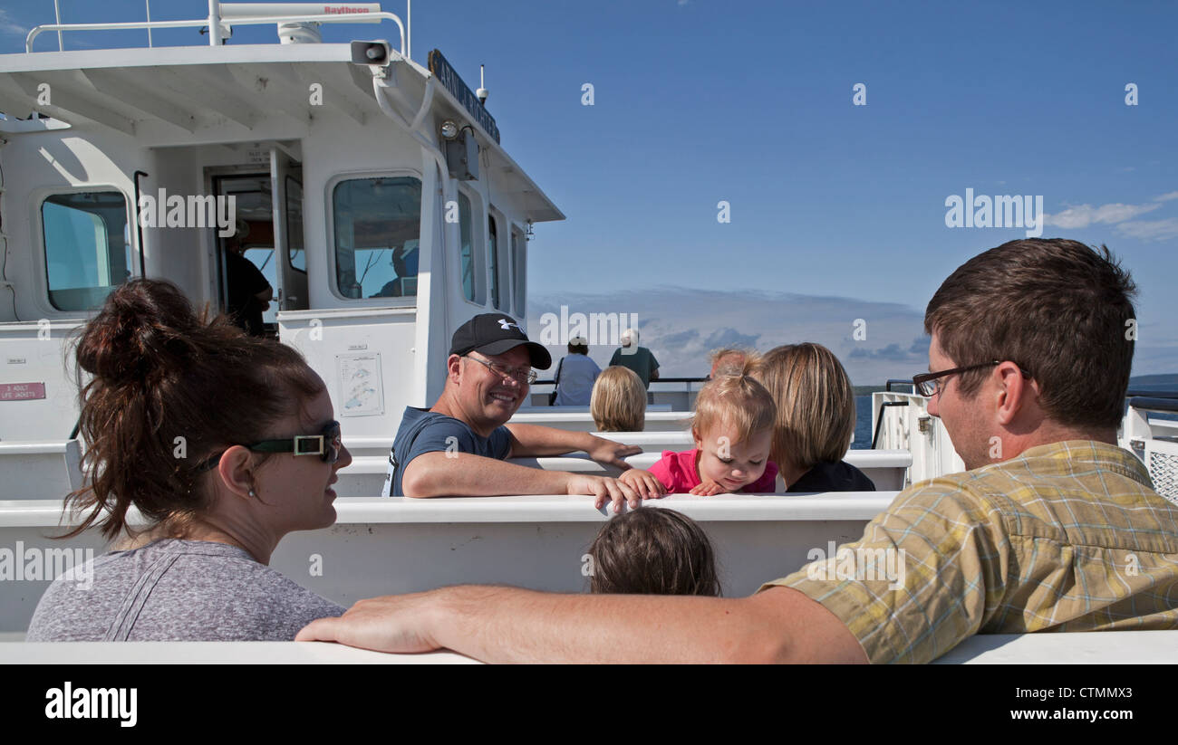 Families enjoy the ferry ride in Door County, Wisconsin. - Stock Image