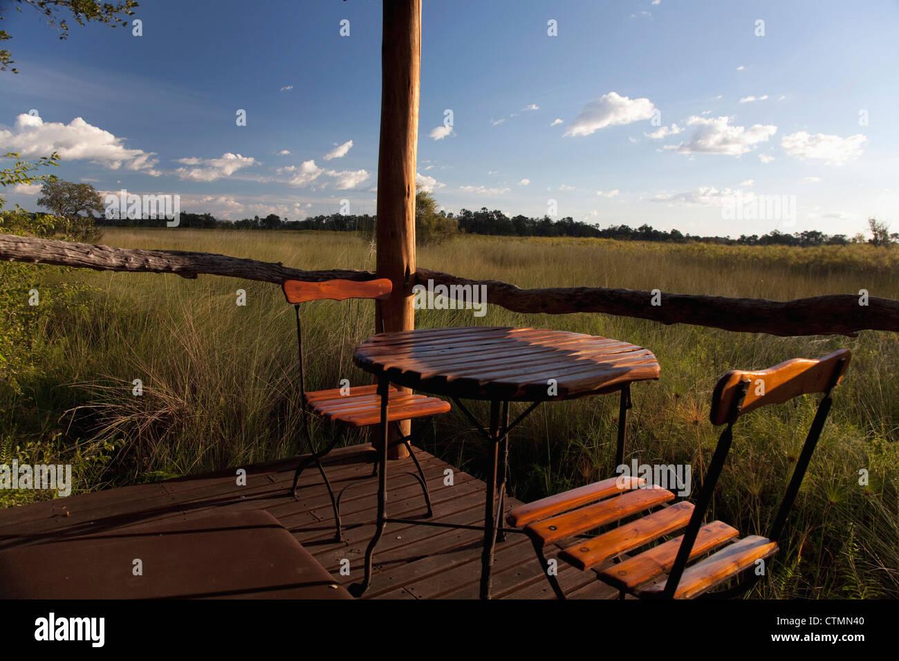 Porch overlooking grassy delta, Okavango Delta, Botswana - Stock Image