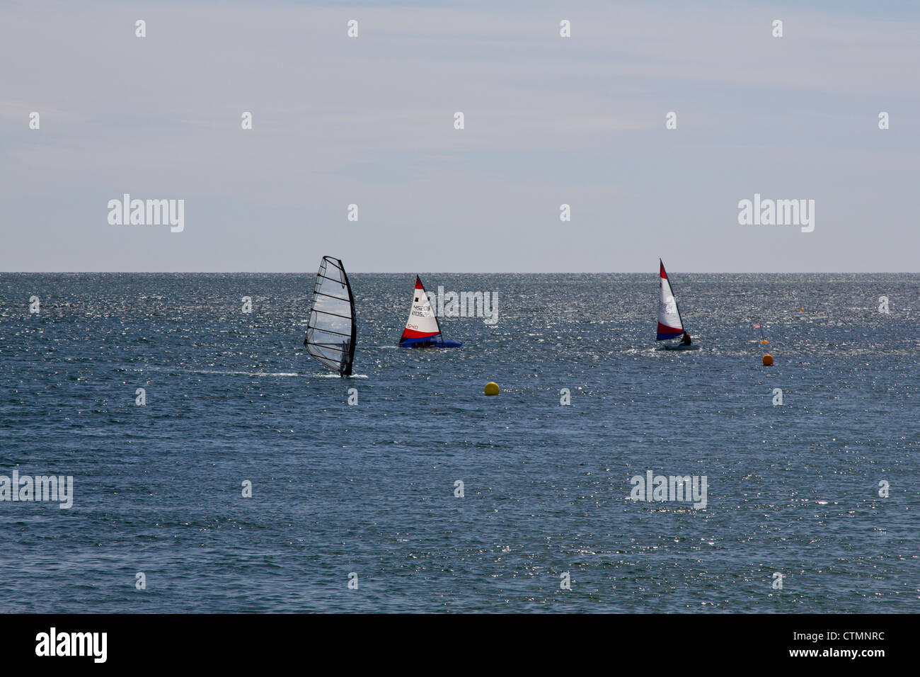 Sailboarding on a shimmering sea at Aberdyfi, north Wales - Stock Image