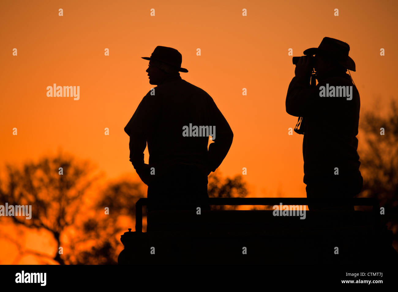 Two silhouettes in sunset, Hlane Big Game Park, Swaziland - Stock Image