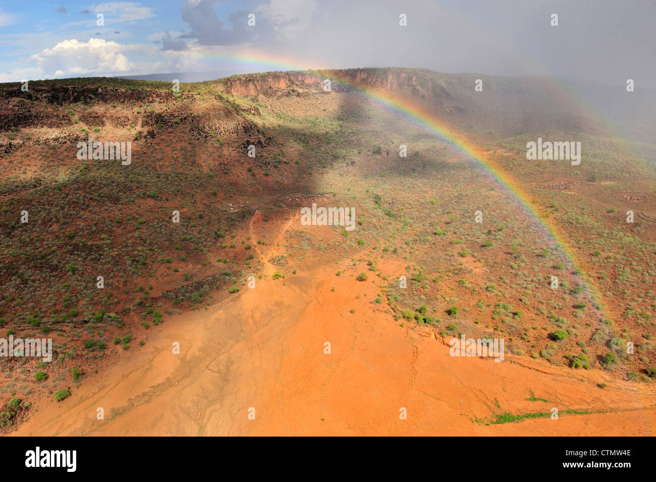 Rainbow after the rains, Taposa villages in Kapoeta district, Republic of South Sudan - Stock Image