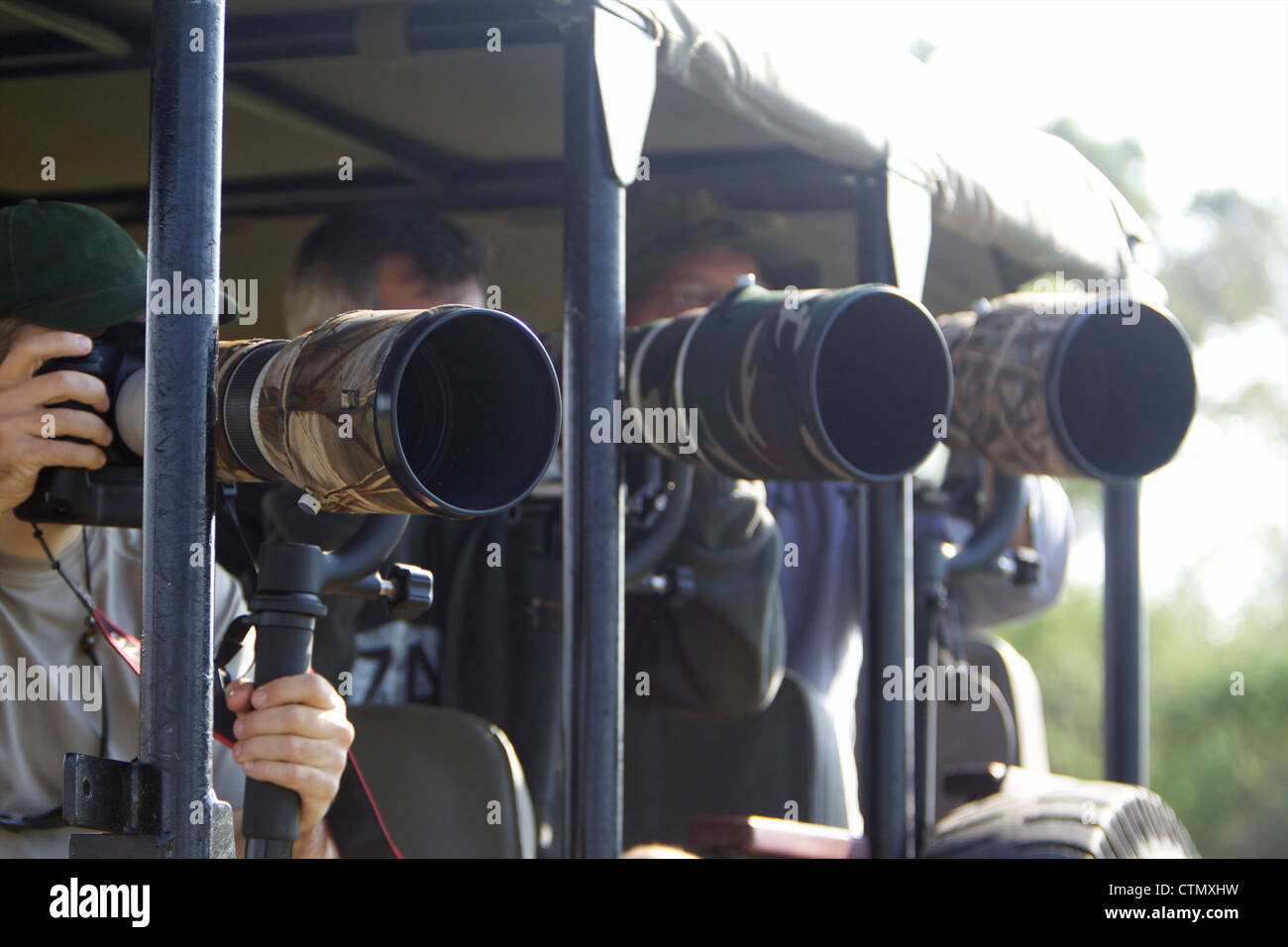 Photographers using large lenses while on safari, Okavango Delta, Botswana Stock Photo
