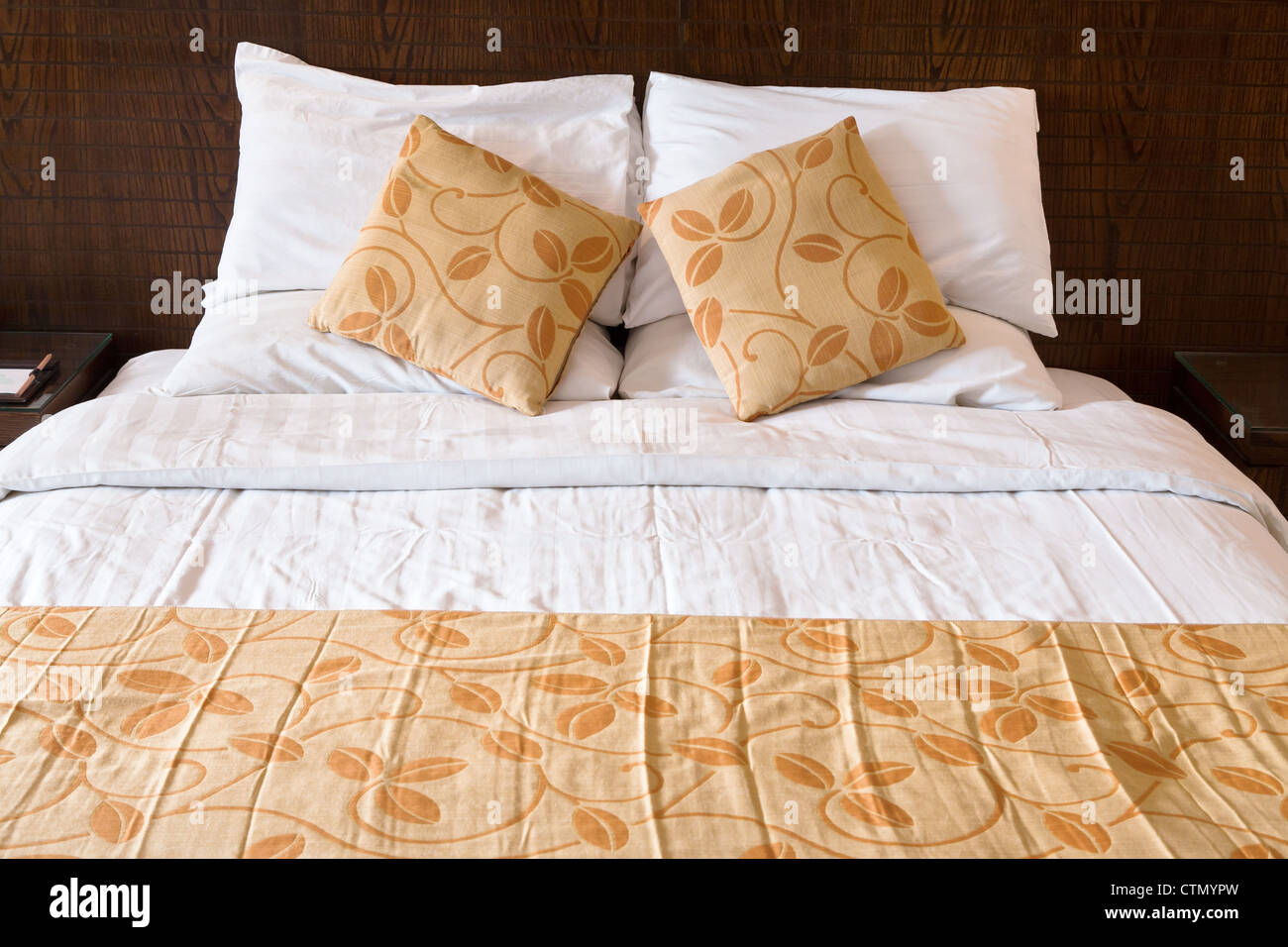 double bed in hotel bedroom - Stock Image