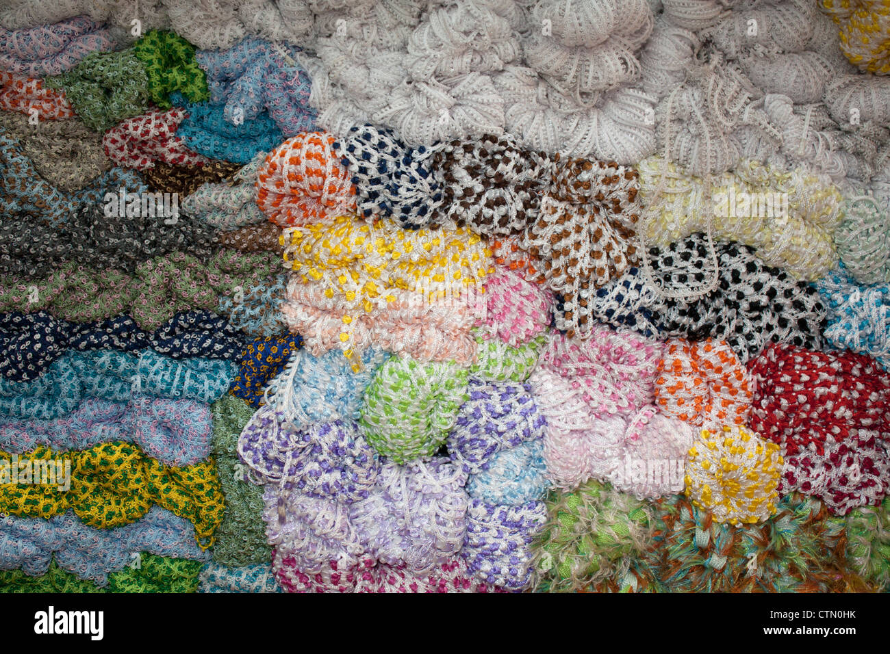 Skeins of trimmings for sale in haberdashery shop in Kinari Bazar, Old Delhi, India - Stock Image