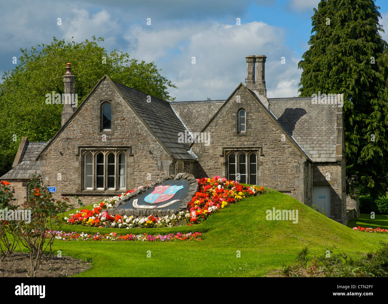 Town coat of arms, surrounded by flowers, Kirkland, Kendal, Cumbria, England UK - Stock Image