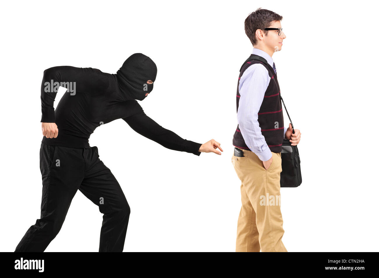 A pickpocket with mask trying to steal a wallet isolated on white background - Stock Image