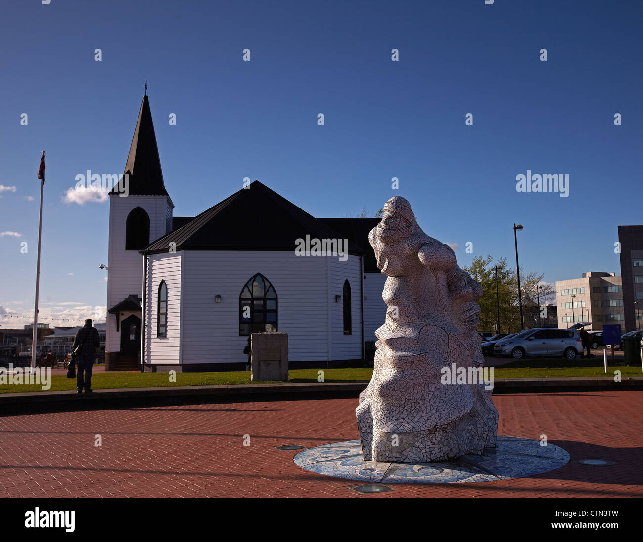 Captain Scot Mosaic sculpture, and the Wooden Norwegian Church, Cardiff Bay, Wales, UK - Stock Image