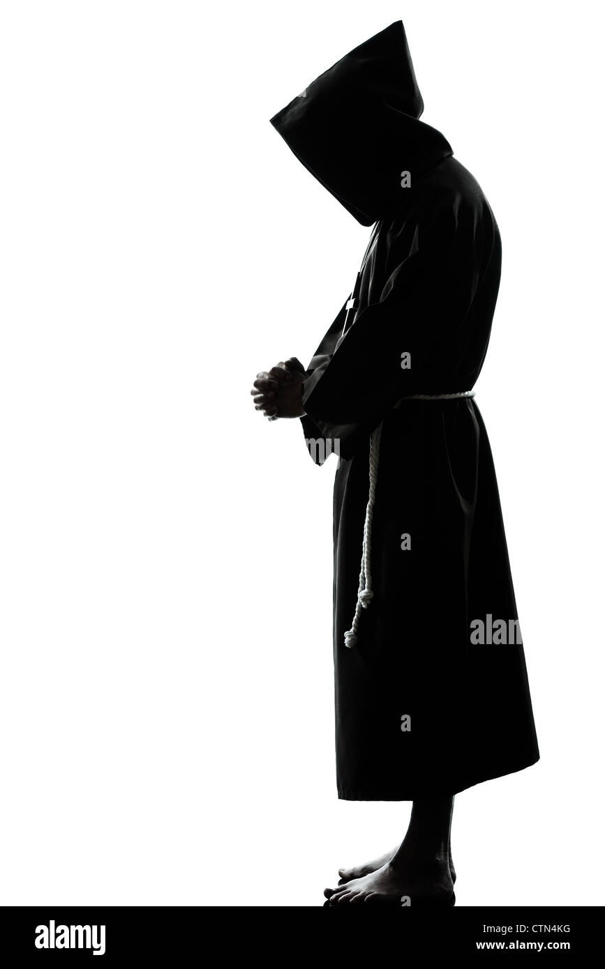 one caucasian man priest praying silhouette in studio isolated on white background - Stock Image