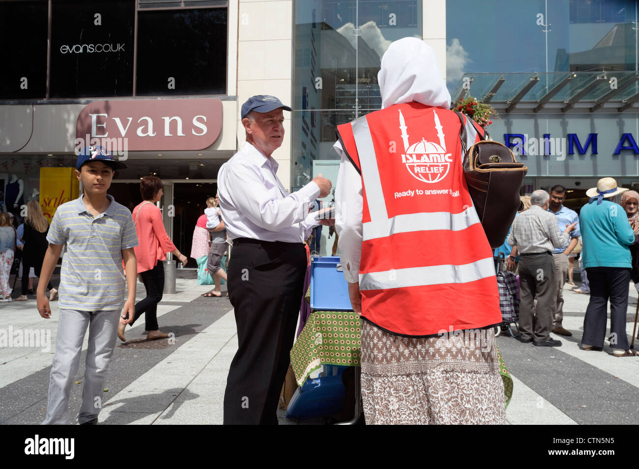 Islamic relief charity collector, Cardiff City Centre, South Wales, UK. - Stock Image