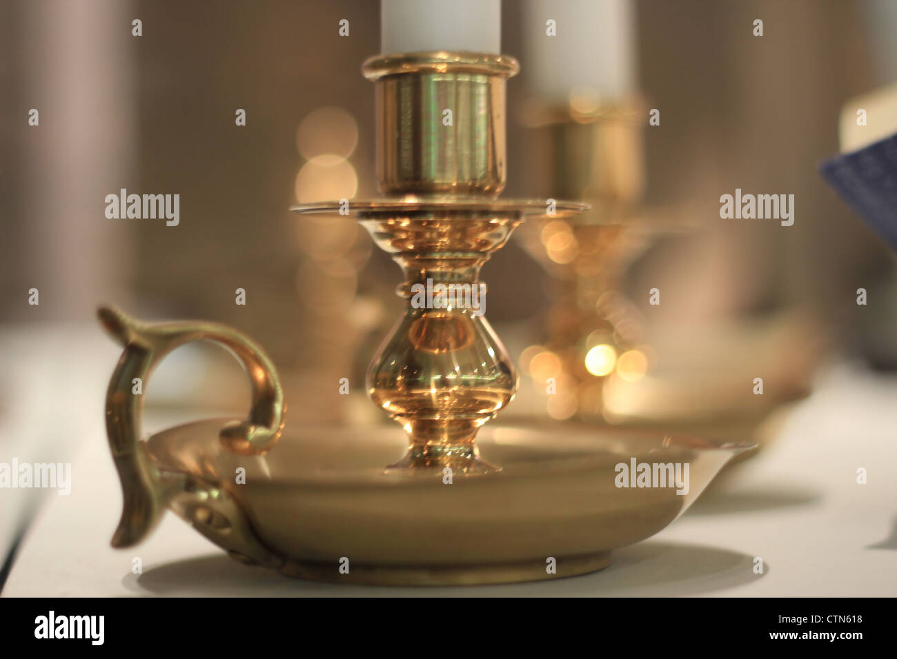 Golden candlestick. - Stock Image