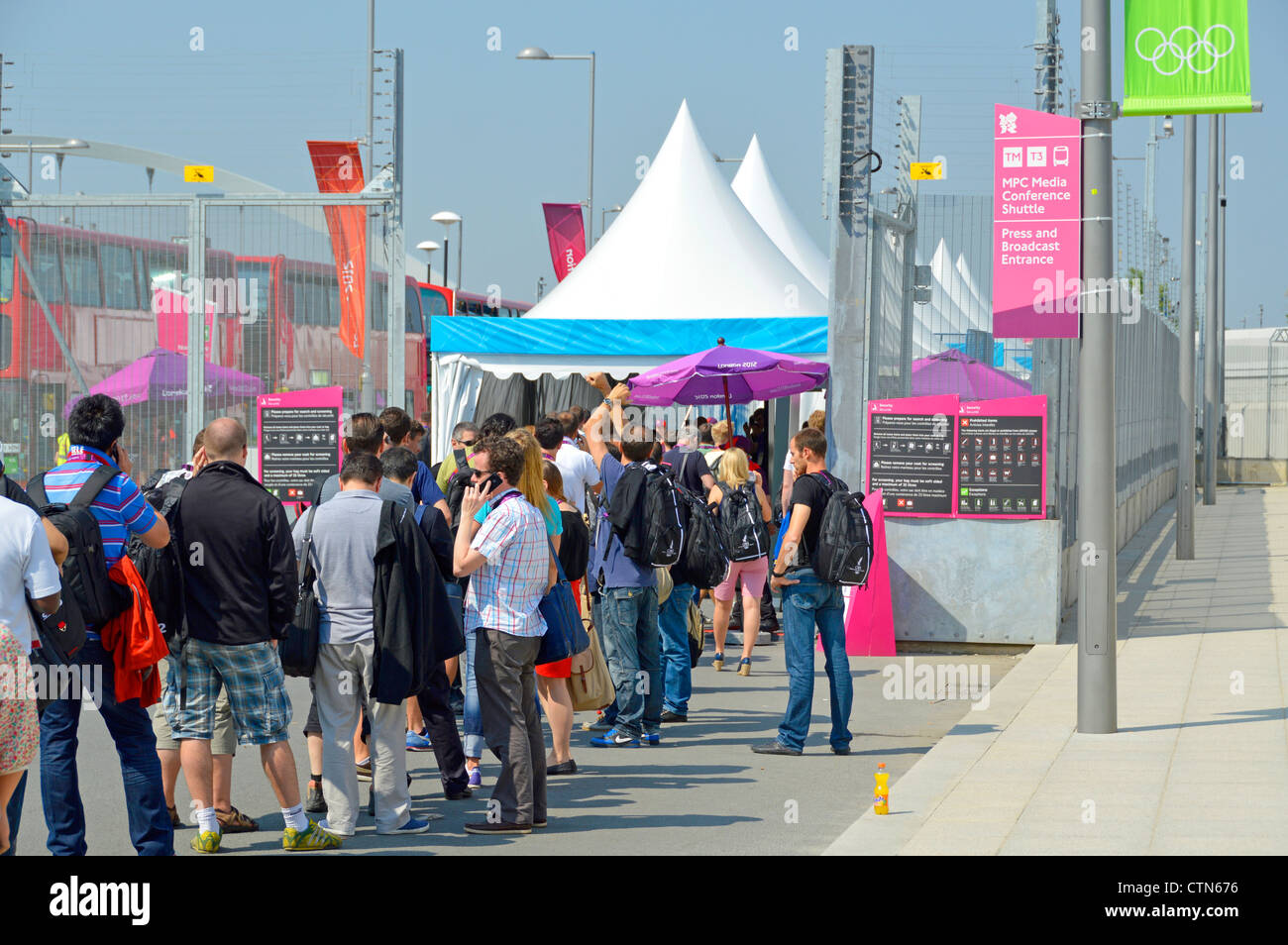 Queue at security check in entry point for media press & broadcasters at London 2012 Olympic Park EDITORIAL USE Stock Photo