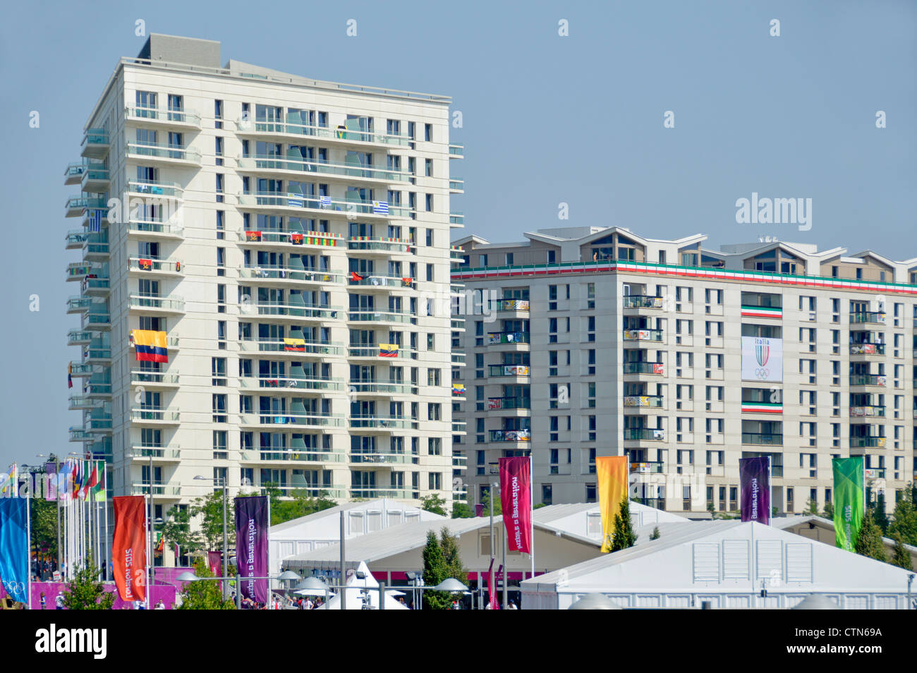 Athletes village and some accomodation blocks seen beyond security fencing at the London 2012 Olympic Park - Stock Image