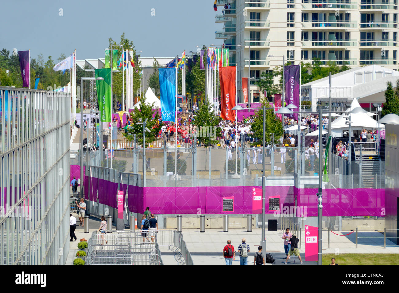 Athletes village & one of the accommodation blocks seen beyond security fencing at London 2012 Olympic Park - Stock Image