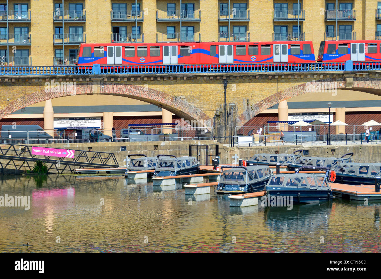 Water taxis moored close to Docklands Light Railway station providing waterborne transport to London 2012 Olympics - Stock Image