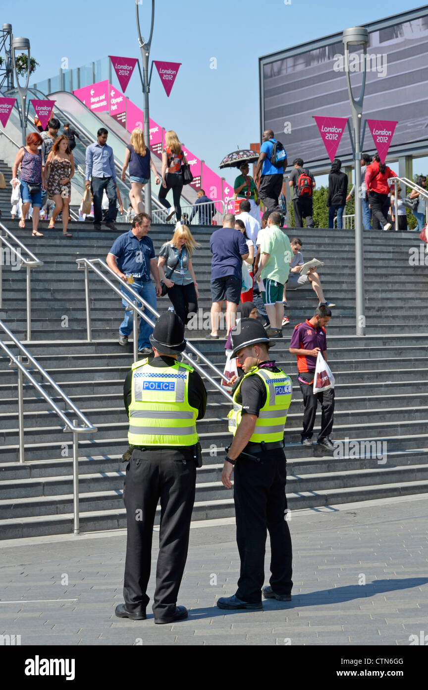 Police officers on duty at entrance steps to the 2012 Olympic Park and the Westfield Stratford City shopping centre - Stock Image