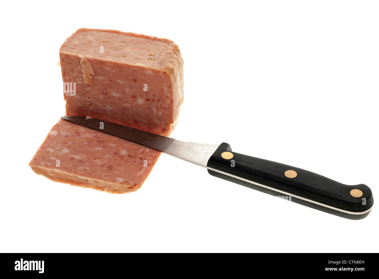 Luncheon meat sliced with a knife - Stock Image