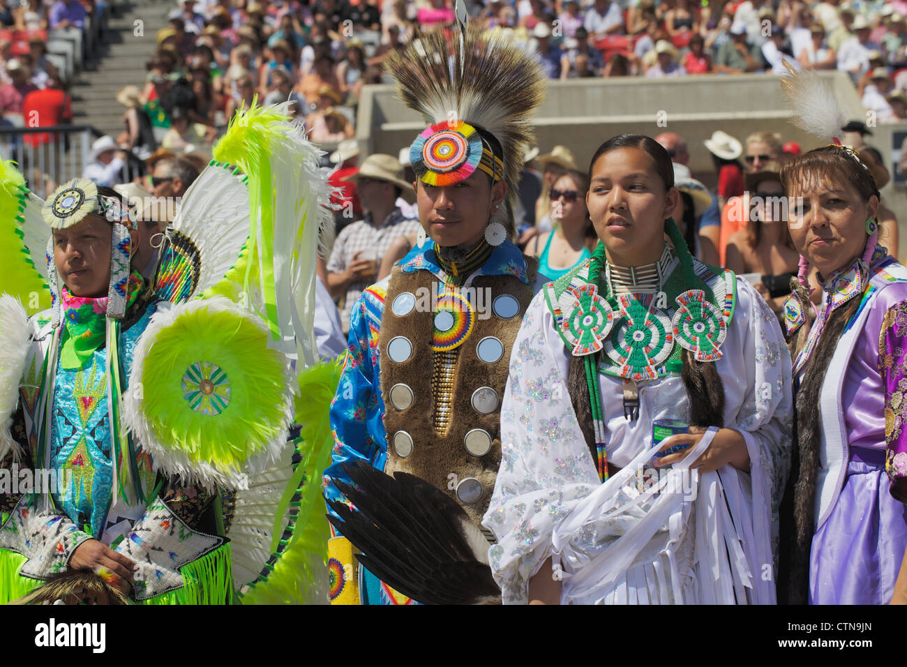 Procession by First Nations people at the Calgary stampede - Stock Image
