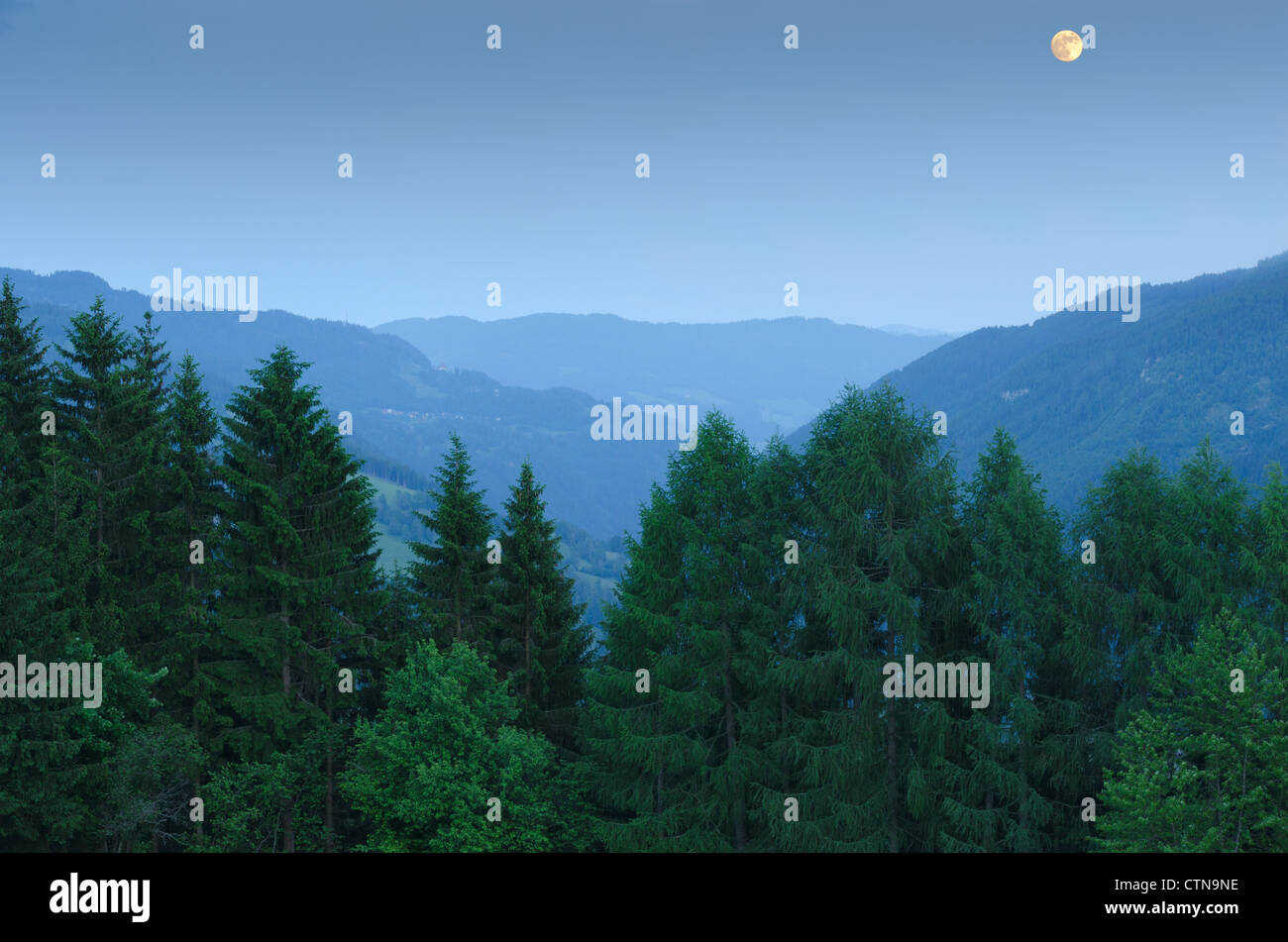 Moonlit Austrian Alpine Landscape. View toward Stolzalpe from the hamlet of Freiberg in the Ranten Valley near Murau, - Stock Image