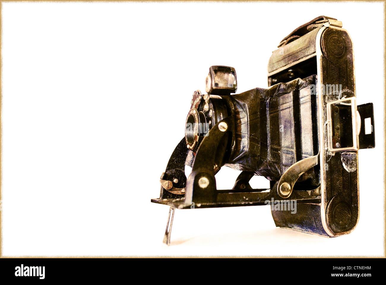 vintage old style photo camera isolated on white background - Stock Image