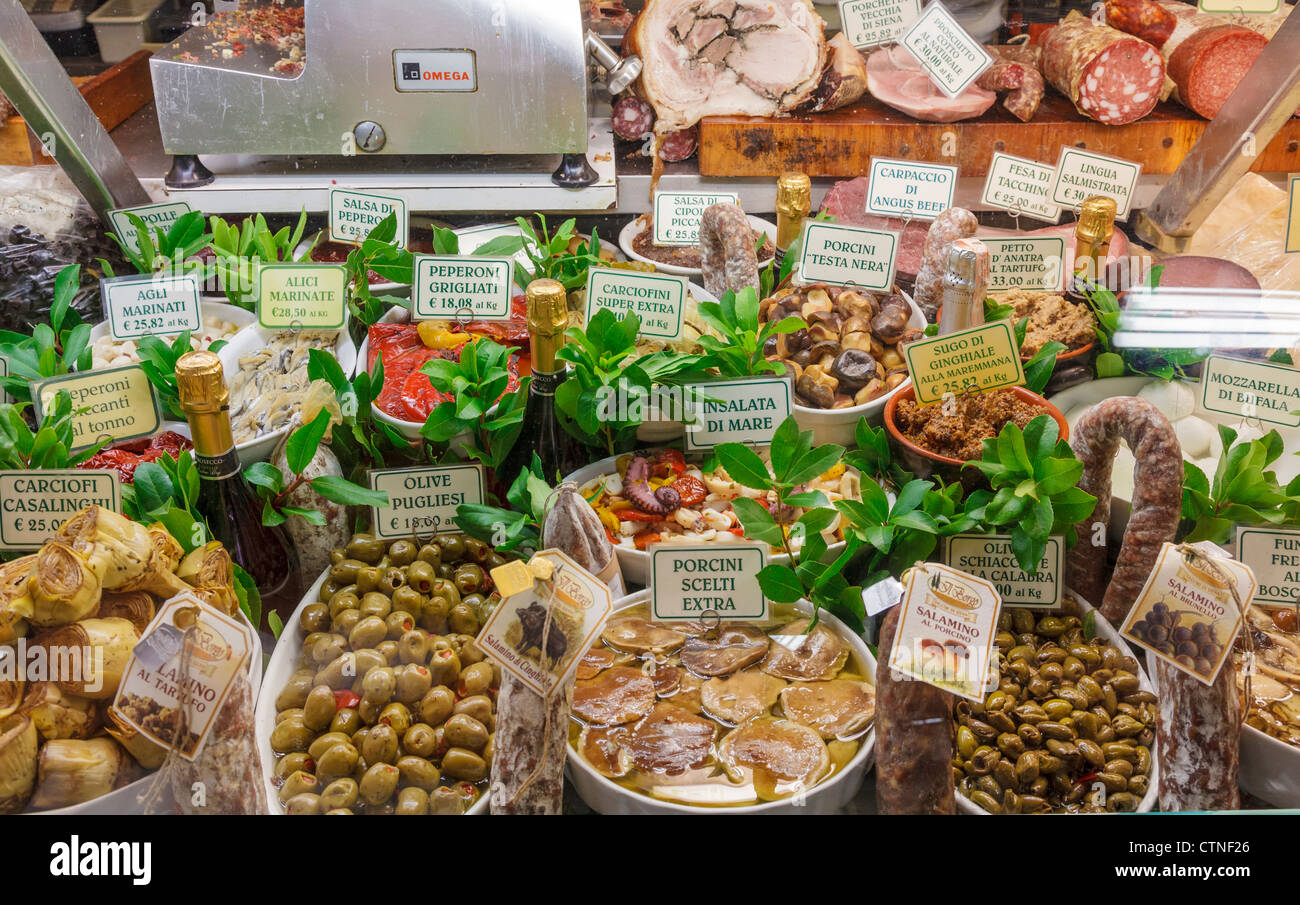 Italian delicacies, such as olives, antipasti, sausages, artichokes, pepperoni,  seafood salad, at Mercato Centrale, - Stock Image