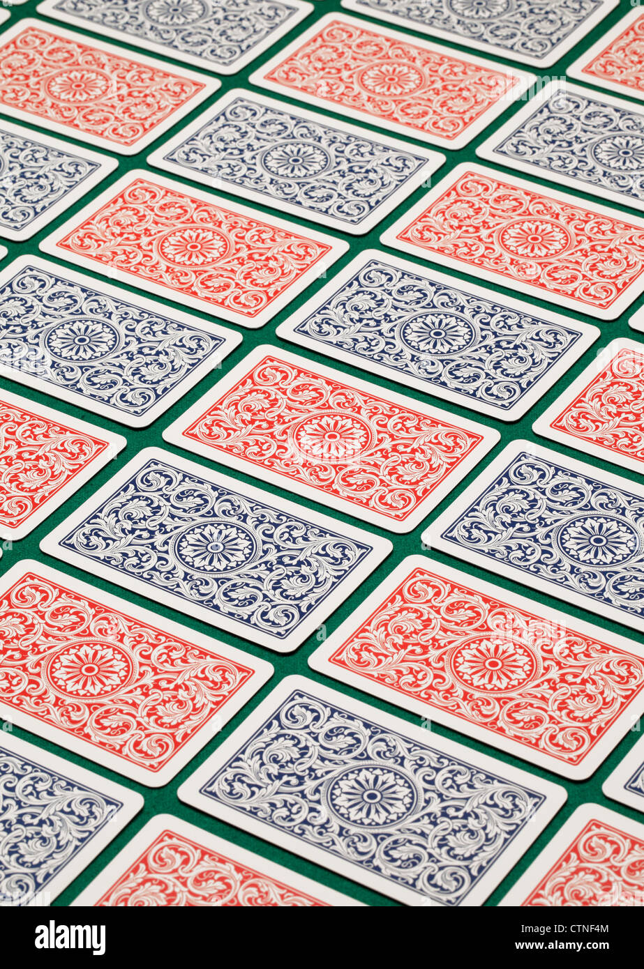 Playing cards on a green table. - Stock Image