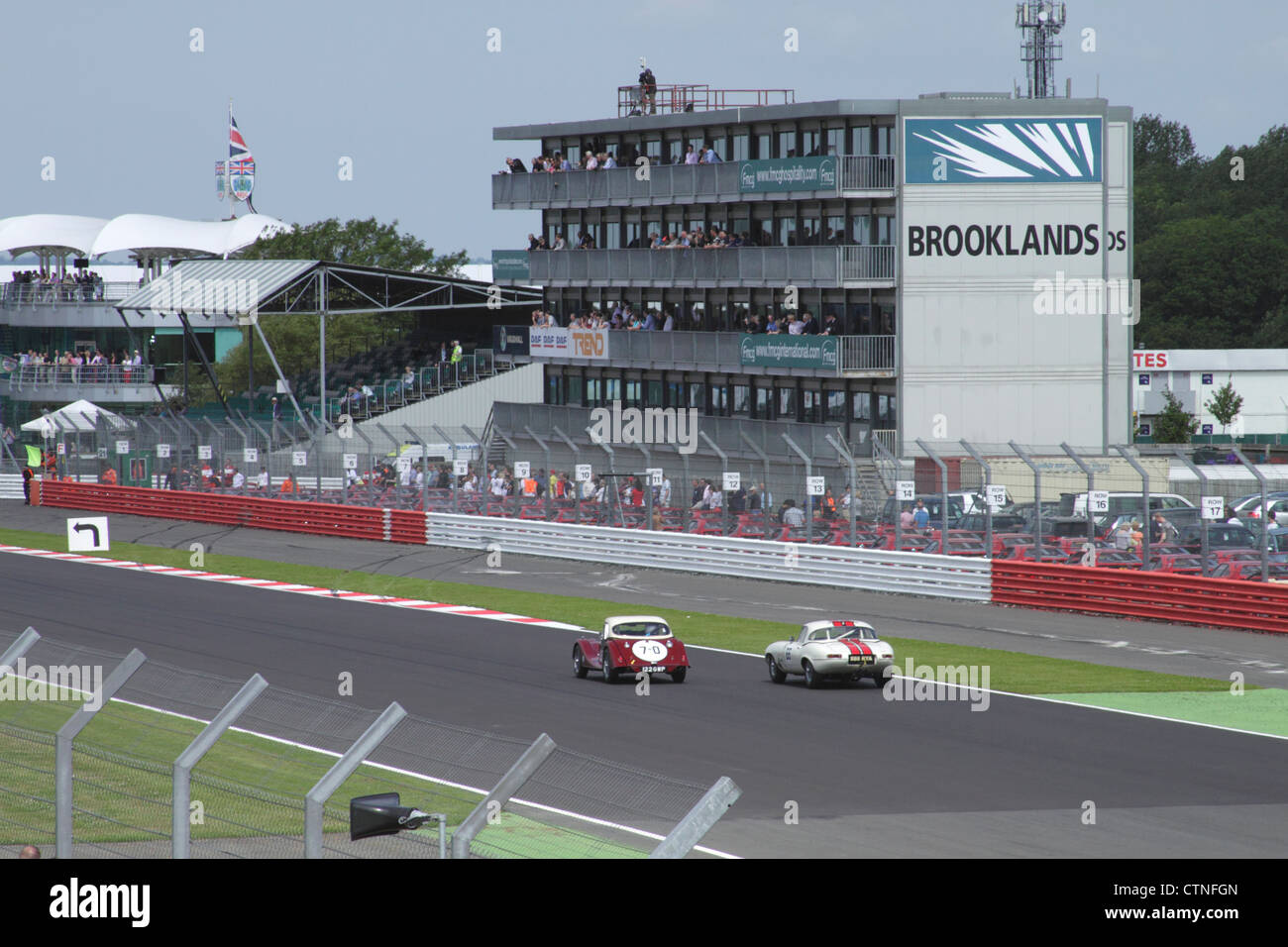 Race at RAC Tourist Trophy for Historic Cars (pre-63 GT) Silverstone Classic July 22 2012 view towards Brooklands - Stock Image